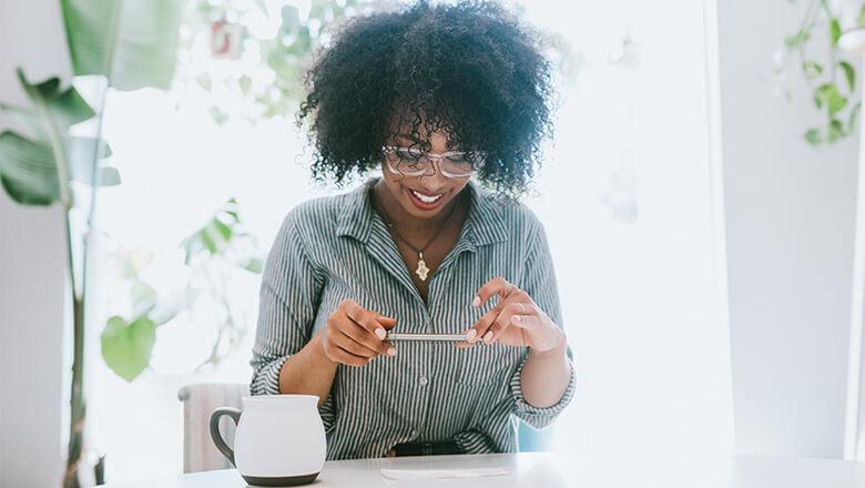 woman making deposit on phone