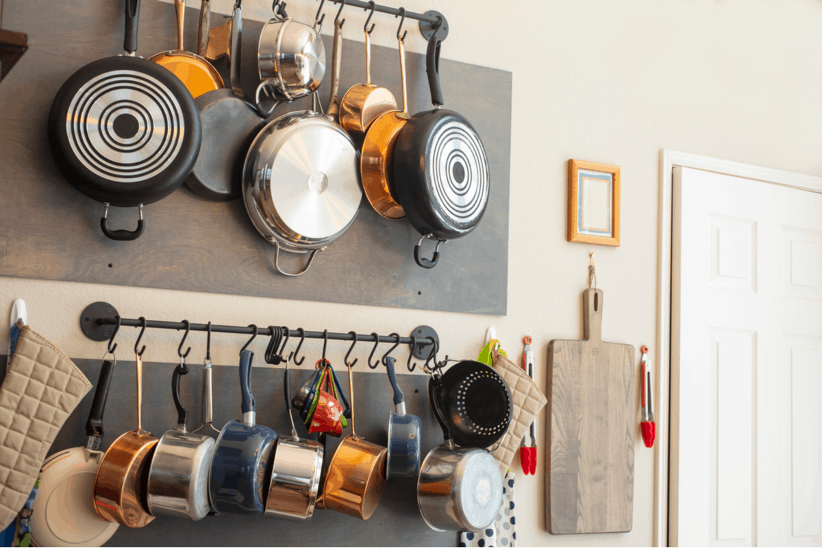 how to organize kitchen cabinets with pots and pans